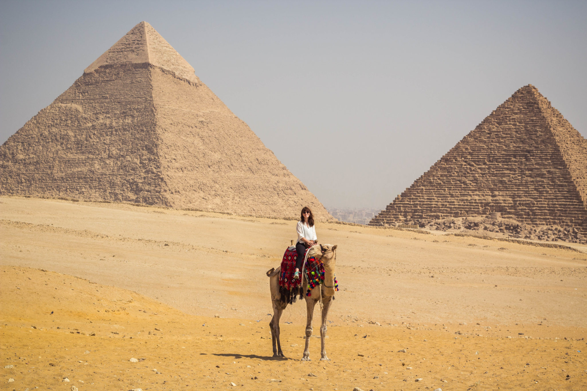 Riding a camel by the Pyramids of Giza in Egypt