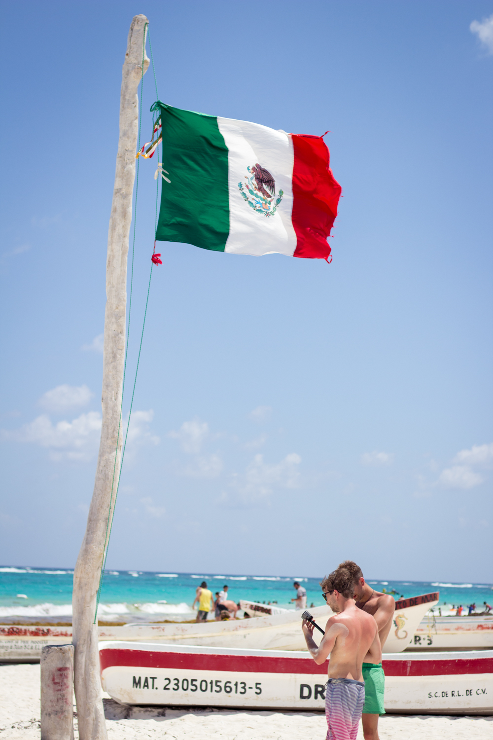 Mexico flag at the beach in Tulum, Mexico