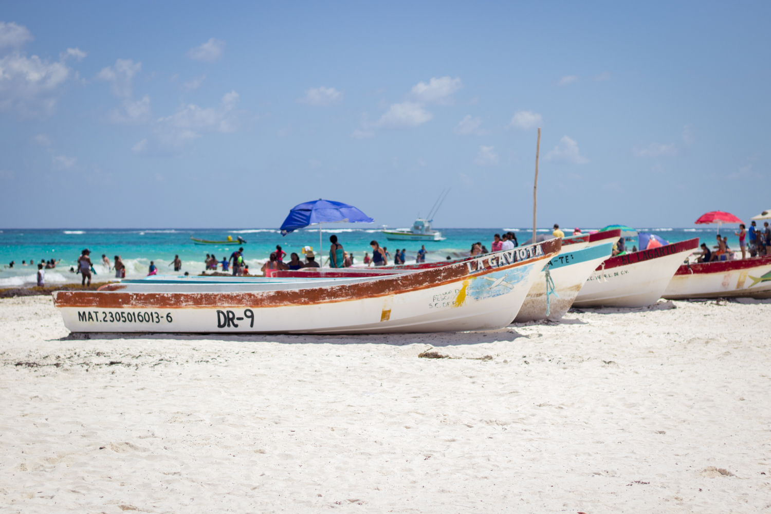 Boats on the beach in Tulum, Mexico