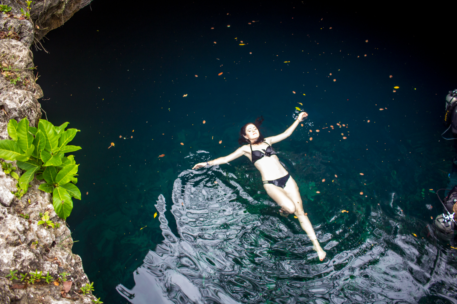 Swimming in the cenotes in Tulum, Mexico
