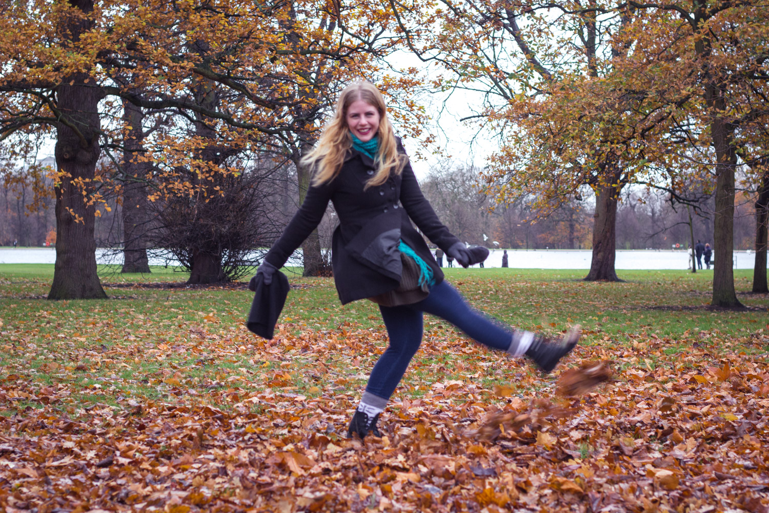 Kicking leaves in Hyde Park London