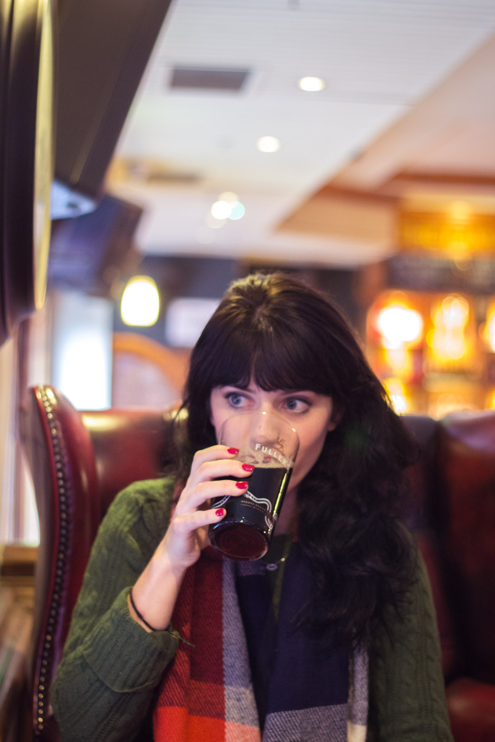 Enjoying a beer in a warm pub in London for Christmas
