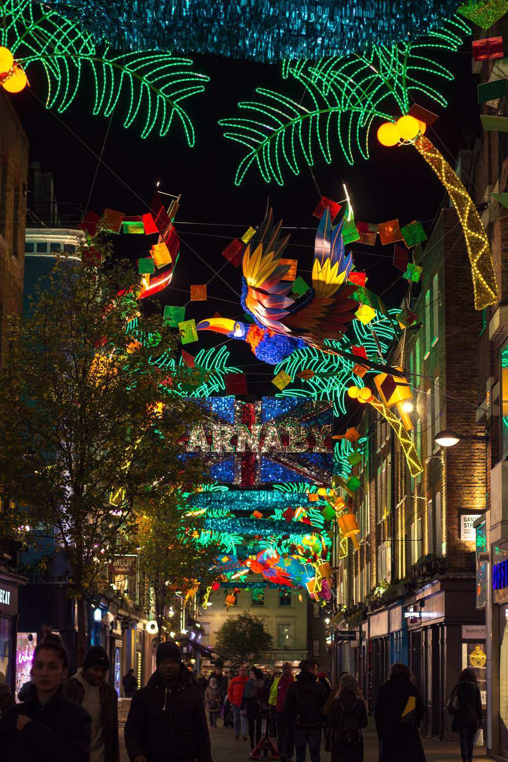Carnaby Street lit up at night in London